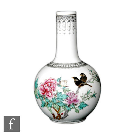 A 20th Century Chinese bottle vase, the white glazed body decorated with flowering lotus branches