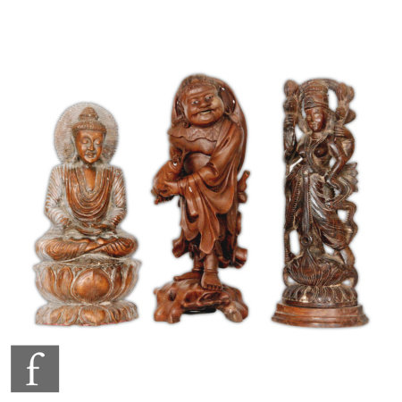 A collection of carved Asian figures, to include a Japanese rootwood figure of Ebisu, modelled