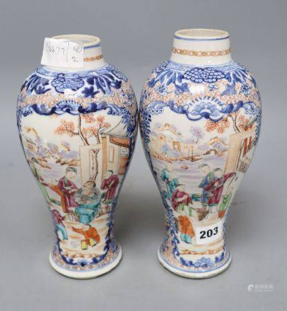 A pair of 18th century Chinese famille rose figural vases, height 25.5cm