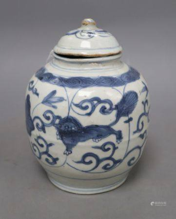 A Chinese Late Ming blue and white 'lion and lotus' jar and cover, overall height 17.5cm, restored