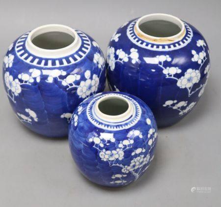 Three Chinese blue and white 'prunus' jars, one with apocryphal kangxi mark