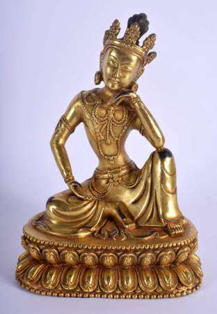 A CHINESE GILT BRONZE FIGURE OF A SEATED BUDDHA 20th Century, modelled upon a triangular base. 22 cm