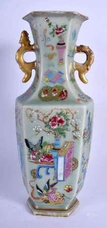 A 19TH CENTURY CHINESE CANTON CELADON FAMILLE ROSE VASE Qing, painted with low tables and foliage. 3
