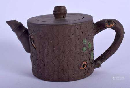 A CHINESE YIXING POTTERY TEAPOT AND COVER 20th century, by Zhou Mei Fen Zhi, overlaid with foliage.