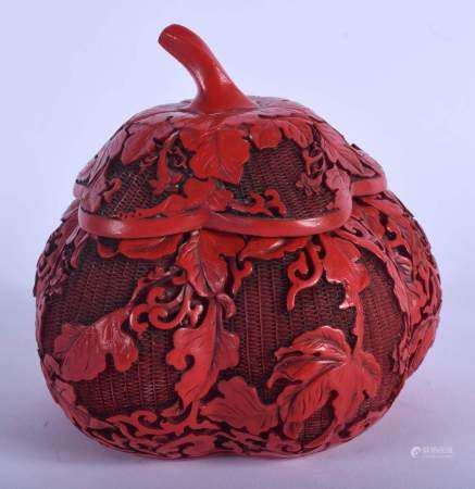 A 1930S CHINESE RED LACQUER MELON FORM BOX AND COVER decorated with foliage. 12 cm x 12 cm.
