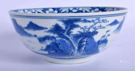 A 19TH CENTURY CHINESE BLUE AND WHITE PORCELAIN BOWL bearing Kangxi marks to base, painted with land