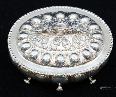 A late Victorian Renaissance Revival silver box and cover, with lobed body on four scroll feet,