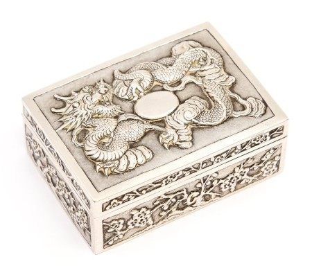 A Chinese 800 standard silver box and cover, the cover chased with three claw dragon in relief