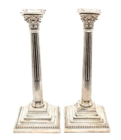 A pair of late Victorian silver Corinthian column large candlesticks, of typical form on stepped