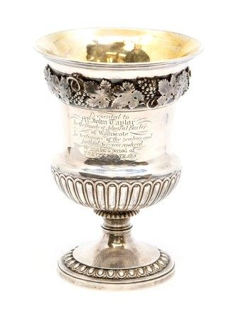 A George III Regency period silver pedestal campana shaped wine goblet, the body with cast
