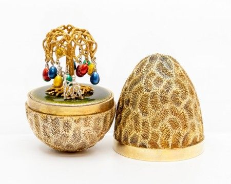 Stuart Devlin silver gilt surprise 'Easter egg tree' egg, decorative textured form opening to reveal