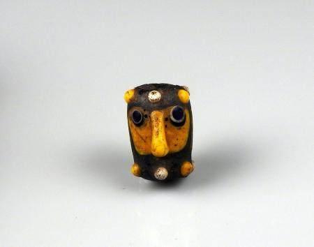 Perle visage cylindrique Pâte de verre 2,4 cm Art phénicien Ier millénaire avant J.-C.