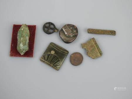 Objets dont celtique dont in sanglier stylisé et divers.Epoque celtique à postéri.