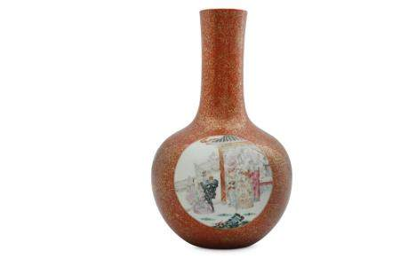 A CHINESE FAMILLE ROSE CORAL-GROUND BOTTLE VASE.