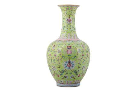 A CHINESE FAMILLE ROSE LIME GREEN-GROUND 'LOTUS' VASE.