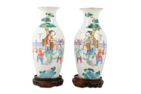 A PAIR OF CHINESE FAMILLE ROSE 'LADY AND BOYS' VASES.
