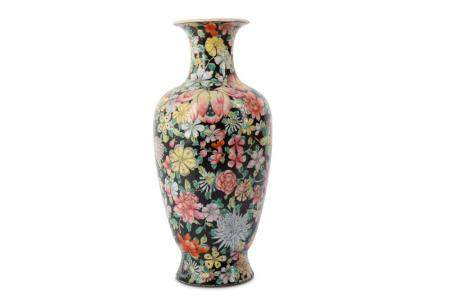 A CHINESE FAMILLE ROSE BLACK-GROUND 'MILLEFLEUR' VASE.