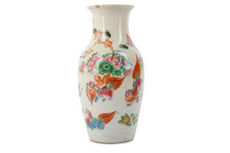 A CHINESE FAMILLE ROSE 'LION DOGS' VASE.
