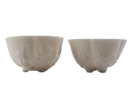 A PAIR OF CHINESE BLANC-DE-CHINE 'PRUNUS BLOSSOM' CUPS.