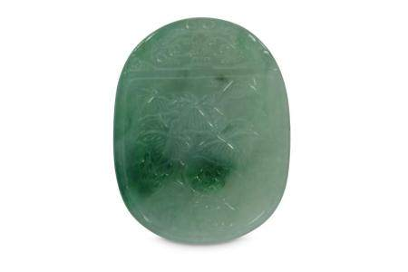 A CHINESE APPLE-GREEN JADEITE PENDANT.
