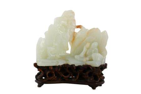 A CHINESE WHITE JADE 'SHOULAO' CARVING.