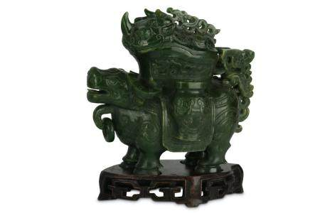 A CHINESE SPINACH-GREEN JADE 'BULL' VESSEL AND COVER, ZUN.