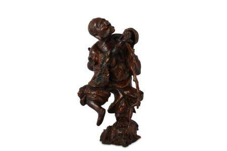 A CHINESE ROOT WOOD FIGURE OF AN ARHAT.