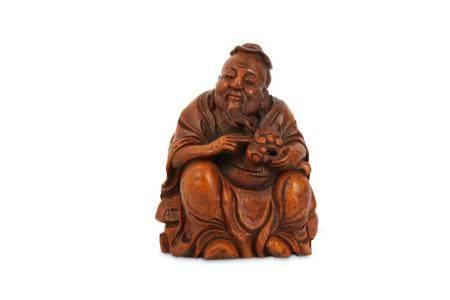 A CHINESE BAMBOO CARVING OF A SAGE.