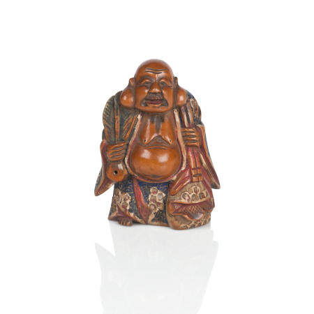 A wood and lacquer netsuke of Fukurokuju 19th century