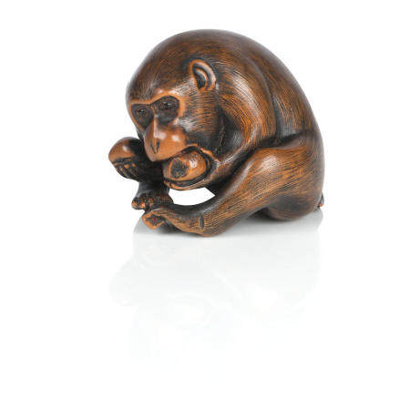 A netsuke of a monkey,  with added Tomokazu signature