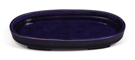AN AUBERGINE-GLAZED OVAL FOOTED TRAY,  QING DYNASTY, 19TH CENTURY