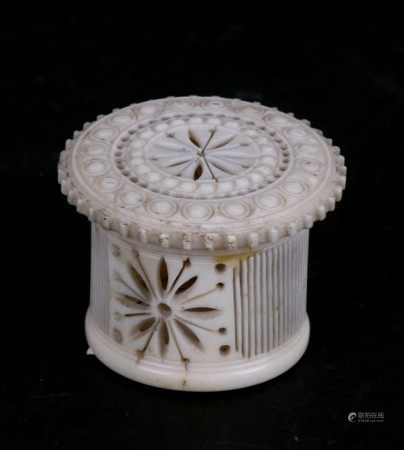 A late 19th century carved bone cricket cage of circular form, 3cms (1.18ins) diameter.Condition