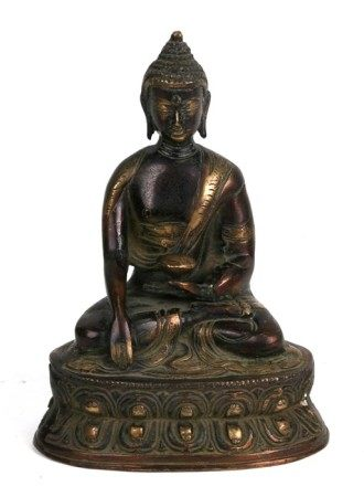 A Chinese bronze Buddha seated in meditation, 20cms (8ins) high.