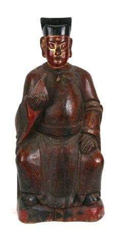A large Chinese carved wooden lacquer and gilded figure depicting a seated dignitary, 56cms (