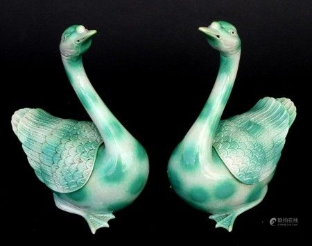 A pair of pottery mottled green glazed Chinese censers in the form of geese, impressed seal mark