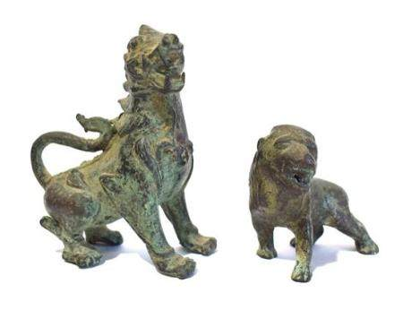 Two Bronze Alloy Wild Beasts each Cast with a Menacing Face