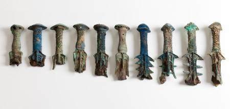 Set of ten sword bronze hilts