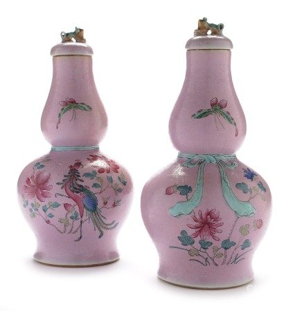 Pair of Chinese famille rose vases and covers