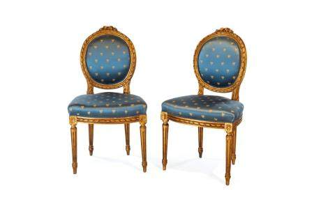 Pair of gilded wooden chairs, late 19th century