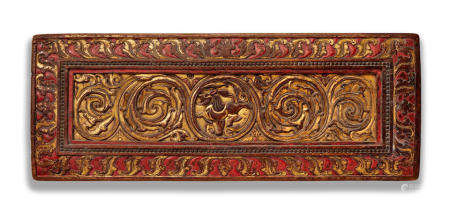 A LARGE GILT LACQUERED WOOD MANUSCRIPT COVER WITH A LION TIBET, CIRCA 13TH CENTURY
