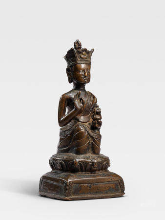 A SILVER AND COPPER INLAID COPPER ALLOY FIGURE OF PHARGYONG TSULTRIM GYELTSEN TIBET, 16TH CENTURY