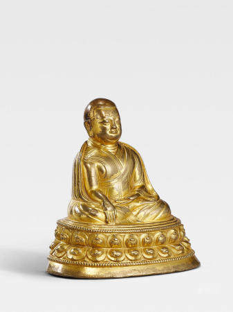"""A GILT COPPER ALLOY FIGURE OF A KAGYU HIERARCH, """"URIWA""""  TIBET, 13TH/14TH CENTURY"""