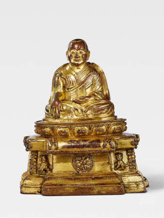 A GILT COPPER ALLOY FIGURE OF LAMA SHANG, FOUNDER OF THE TSELPA KAGYU ORDER TIBET, 13TH/14TH CENTURY