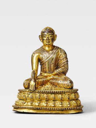 A SILVER INLAID GILT COPPER ALLOY FIGURE OF THE FOUNDER OF THE DRIGUNG KAGYU ORDER, JIGTEN SUMGON RINCHEN PEL TIBET, 13TH/14TH CENTURY
