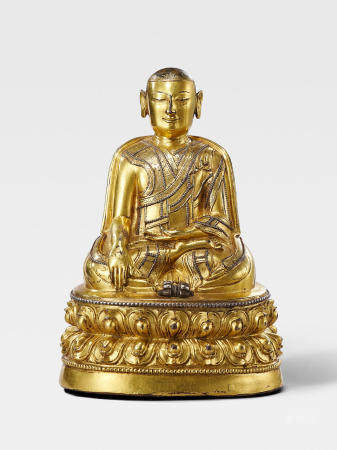 A SILVER INLAID GILT COPPER ALLOY FIGURE OF A TAKLUNG KAGYU LAMA TIBET, CIRCA 14TH CENTURY