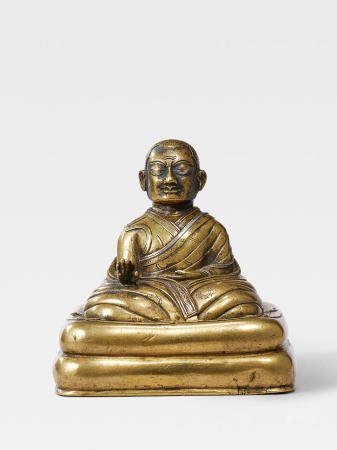 A SILVER AND COPPER INLAID BRASS FIGURE OF A KAGYU HIERARCH  TIBET, 13TH/14TH CENTURY