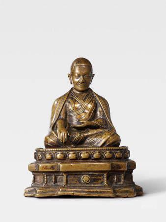A BRASS FIGURE OF A LAMA  TIBET, 13TH/14TH CENTURY