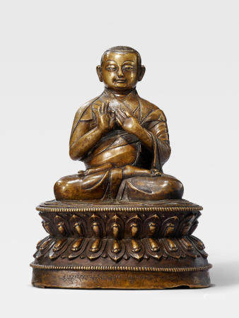 A SILVER AND COPPER INLAID BRASS FIGURE OF NAMKHA GYELTSEN TIBET, 15TH/16TH CENTURY
