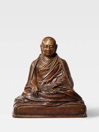 A COPPER ALLOY FIGURE OF A KARMA KAGYU LAMA, POSSIBLY THE SIXTH SHAMARPA, MIPAM CHOKYI WANGCHUK TIBET, 17TH CENTURY