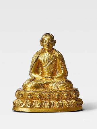 A GILT COPPER ALLOY FIGURE OF BUDDHASHRI  TIBET, 14TH CENTURY